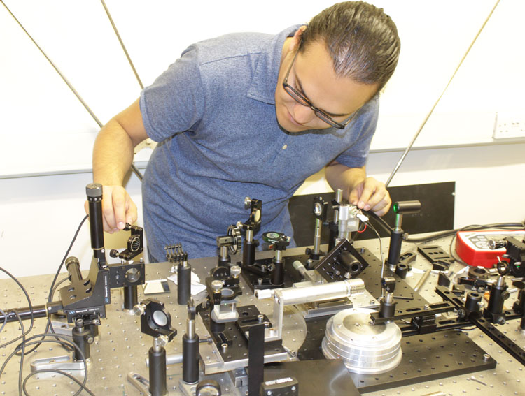 Osvaldo is aligning the angle-resolved micro-PL set-up to measure first microcavities with 2D films