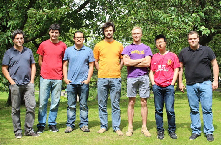 Outside the lab on a sunny day: Sasha, Hakan, Osvaldo, Tillmann, Robert, Le, Stefan (picture by Freddie Withers, Manchester)